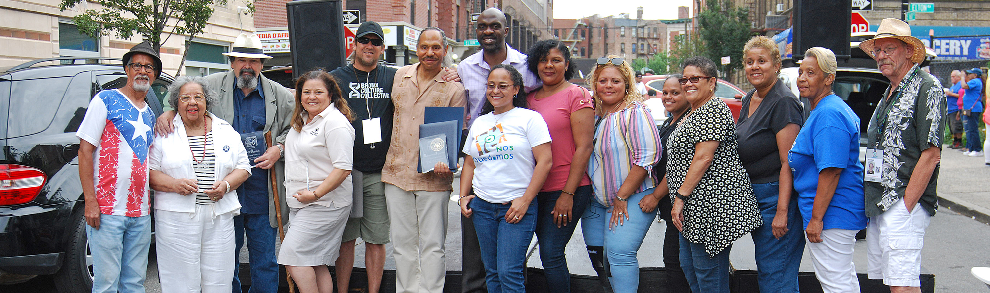 """We Are Melrose"" 2018 Street Fair. Recipients of the Harvesting Culture Awards are flanked by Nos Quedamos staff and NYS Assembly Michael Blake."
